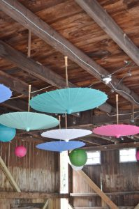 I strung lots of globe lights across the ceiling and then hung the parasols and paper lanterns.