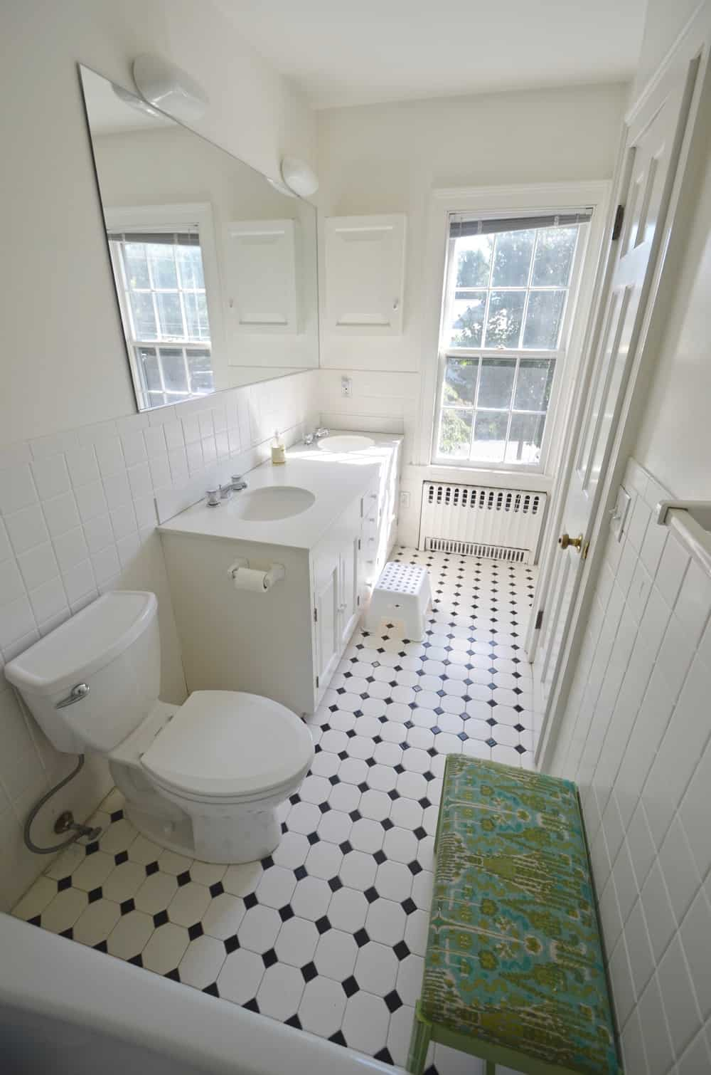 design board for taking a neutral bathroom to navy