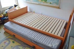 Simple DIY trundle bed to bring in extra sleeping in a kids room.