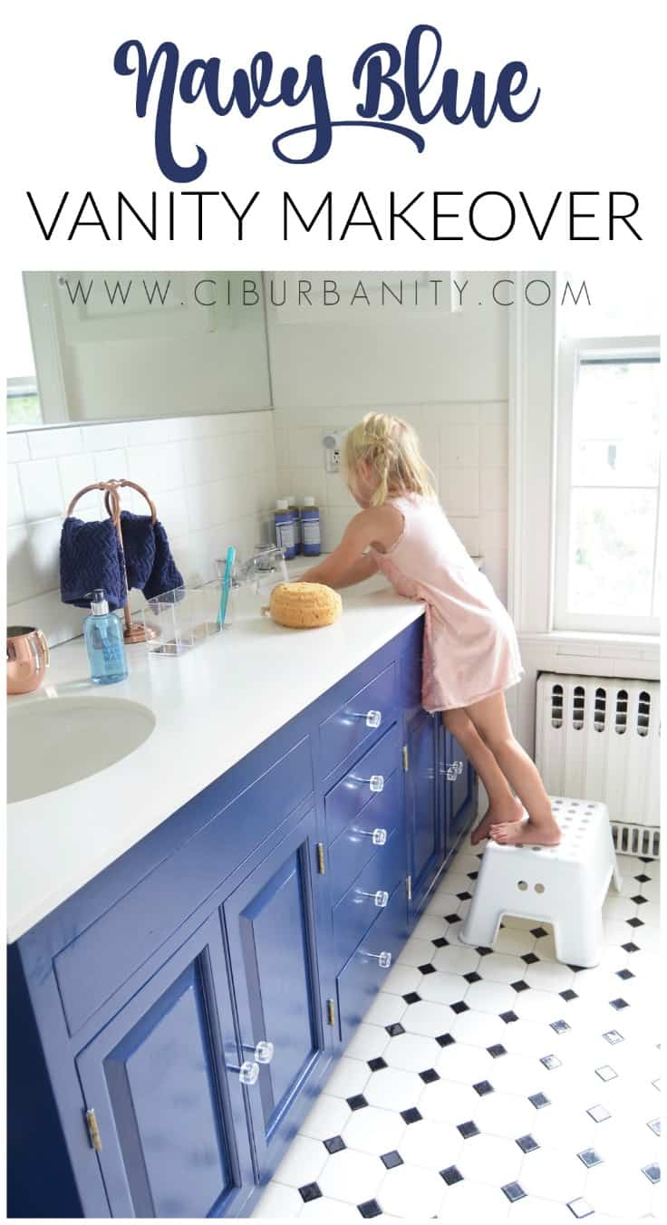 Repainting a basic white vanity with navy blue Satin Enamel paint for an easy bathroom makeover!