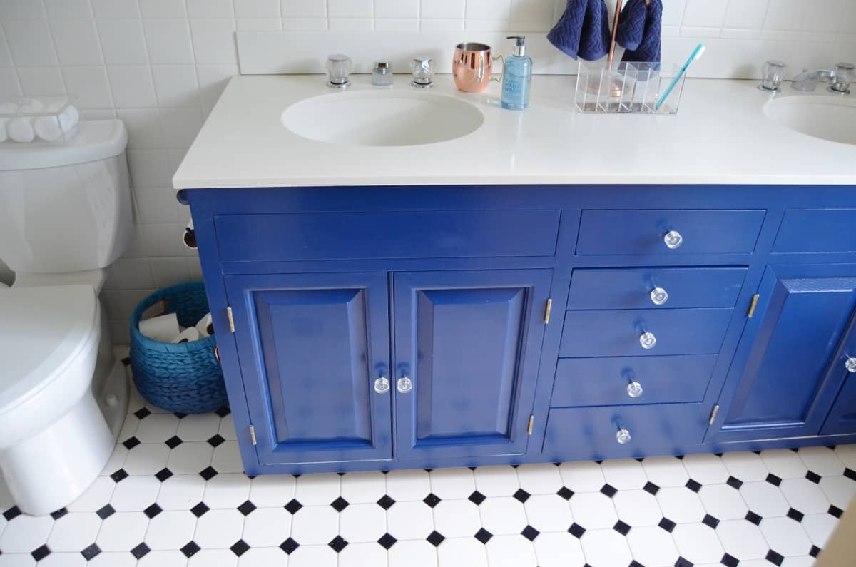Bathroom With Painted Blue Vanity At Charlotte S House