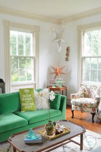 White bright living room with colorful decor and eclectic design.