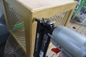 nail-gun-to-attach-wooden-sides