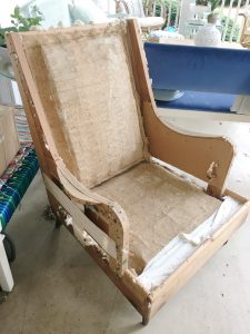 Preparing an old craigslist chair to be repholstered.