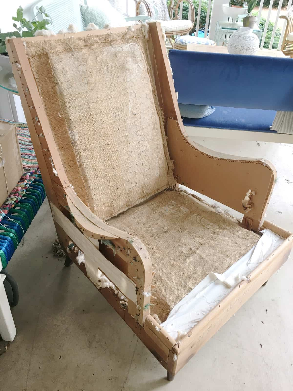 Preparing an old craigslist chair to be reupholstered.