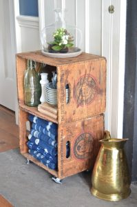 Thrifty storage from flea market crates on casters.