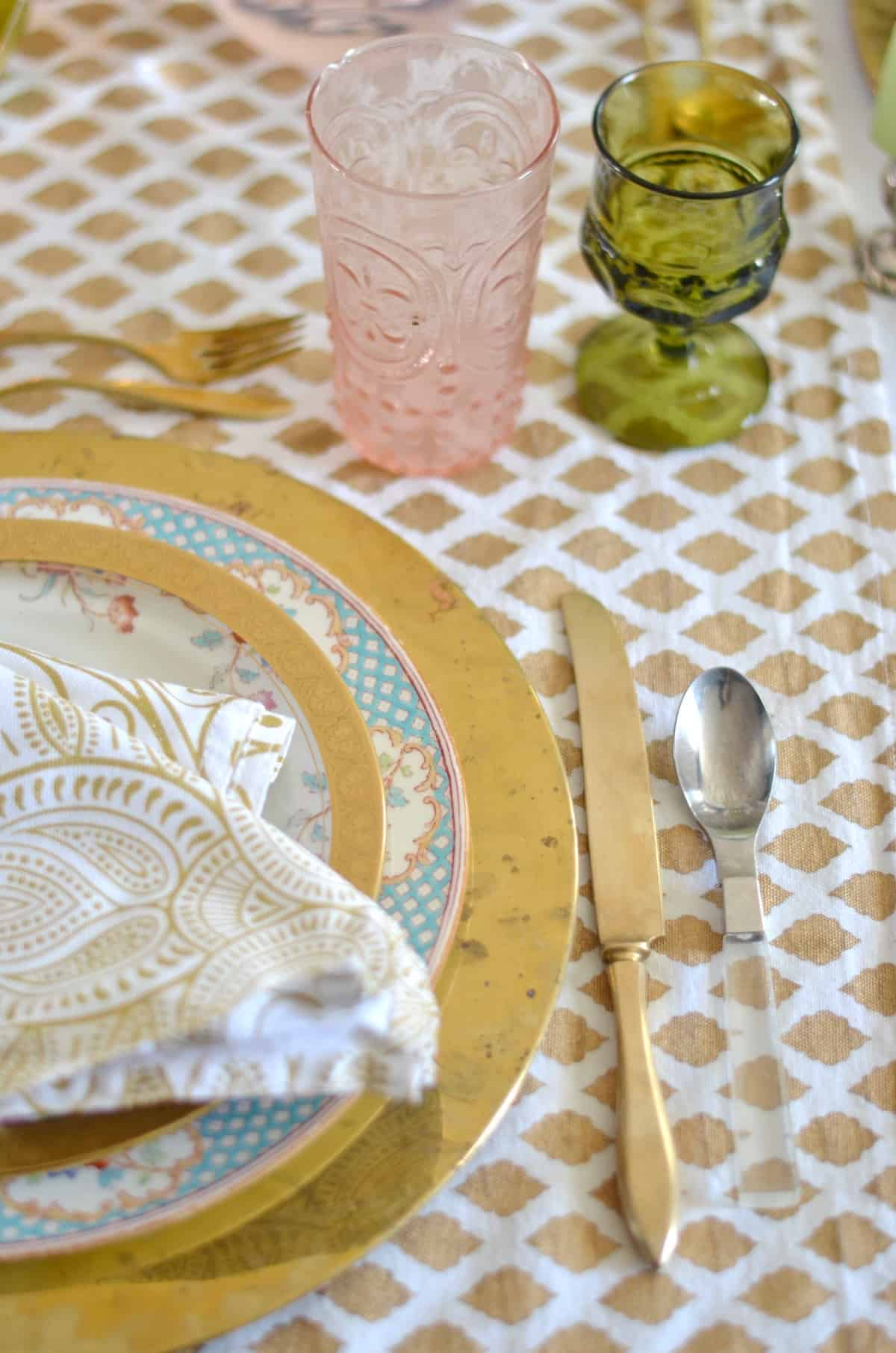 Pink and green and floral eclectic Thanksgiving tablescape.