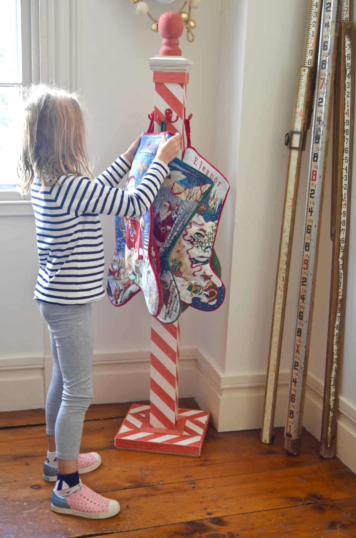 DIY striped lattice holiday stocking post- adorable way to display your stockings this season!