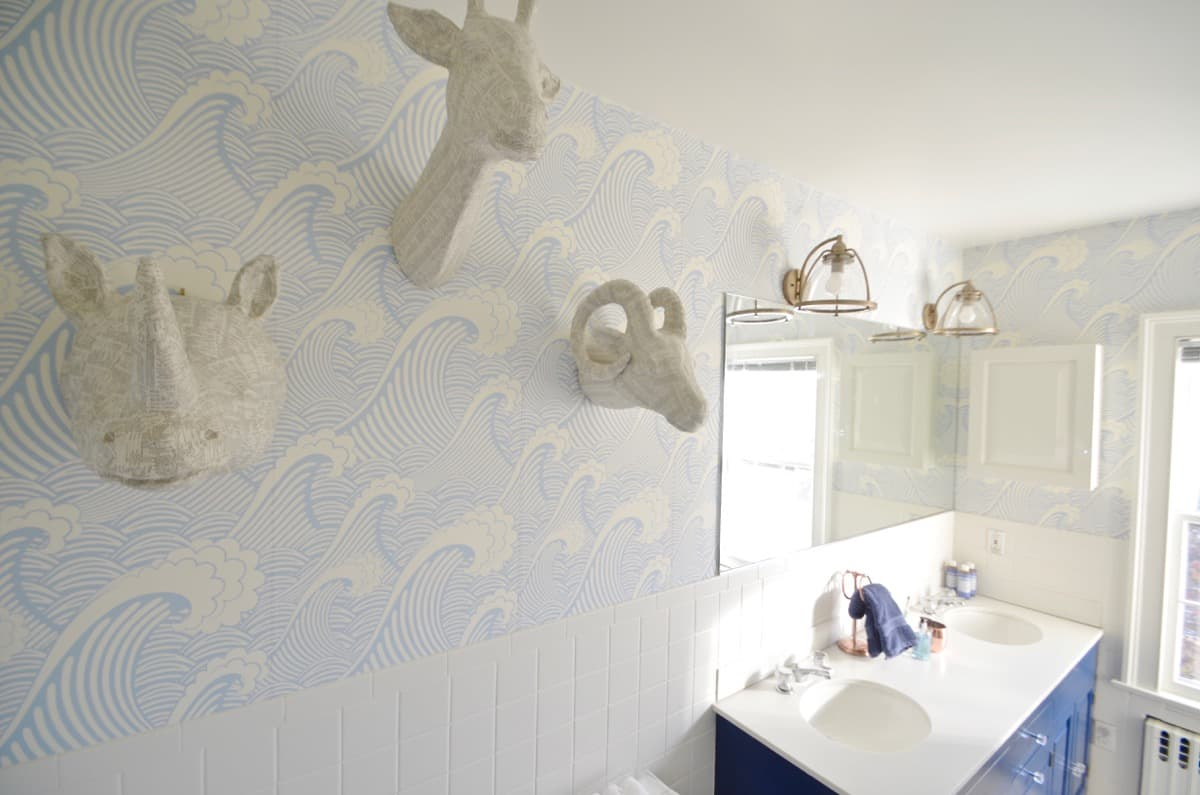 Updated kids bathroom with wallpaper and new pendant lights.
