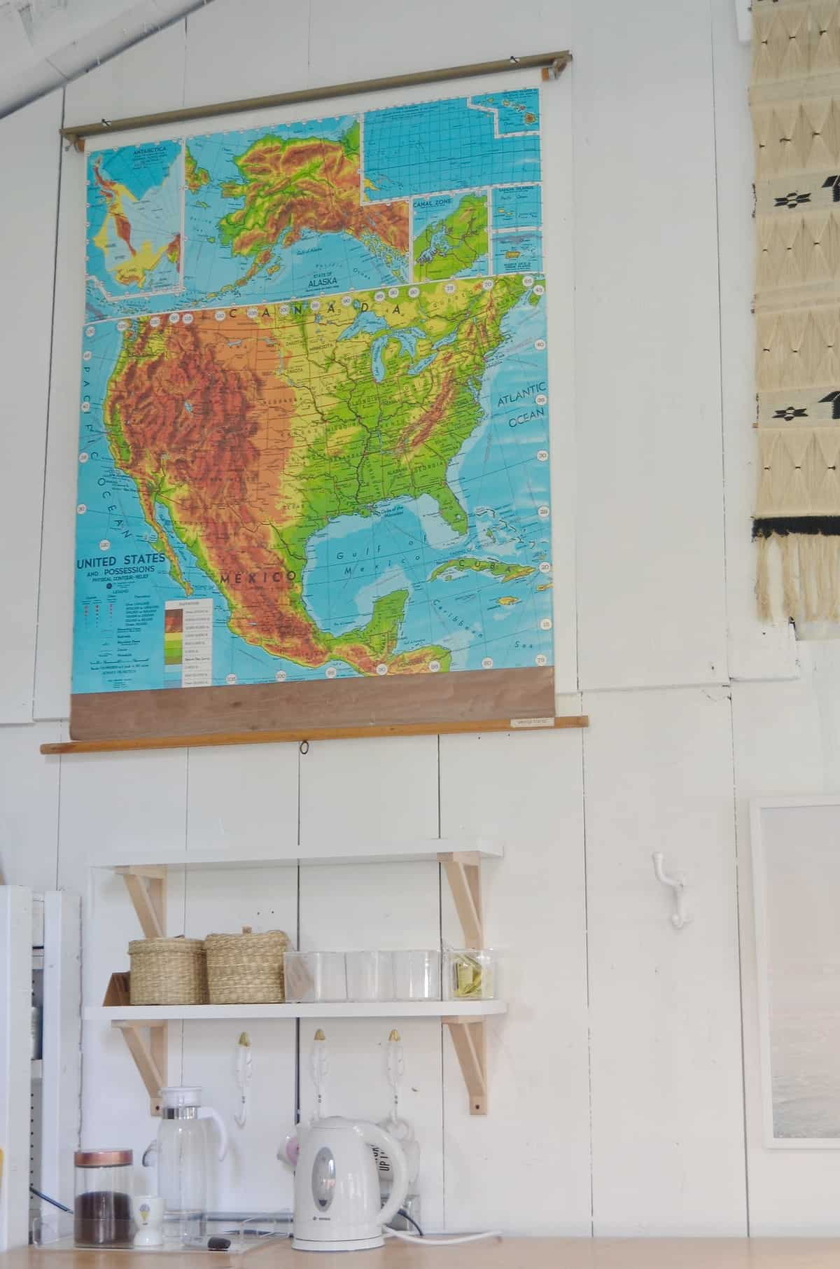 Hanging artwork in the shed for the one room challenge.