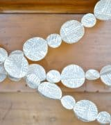 Easy and inexpensive paper garland... make this for under $1 and decorate your entire room!
