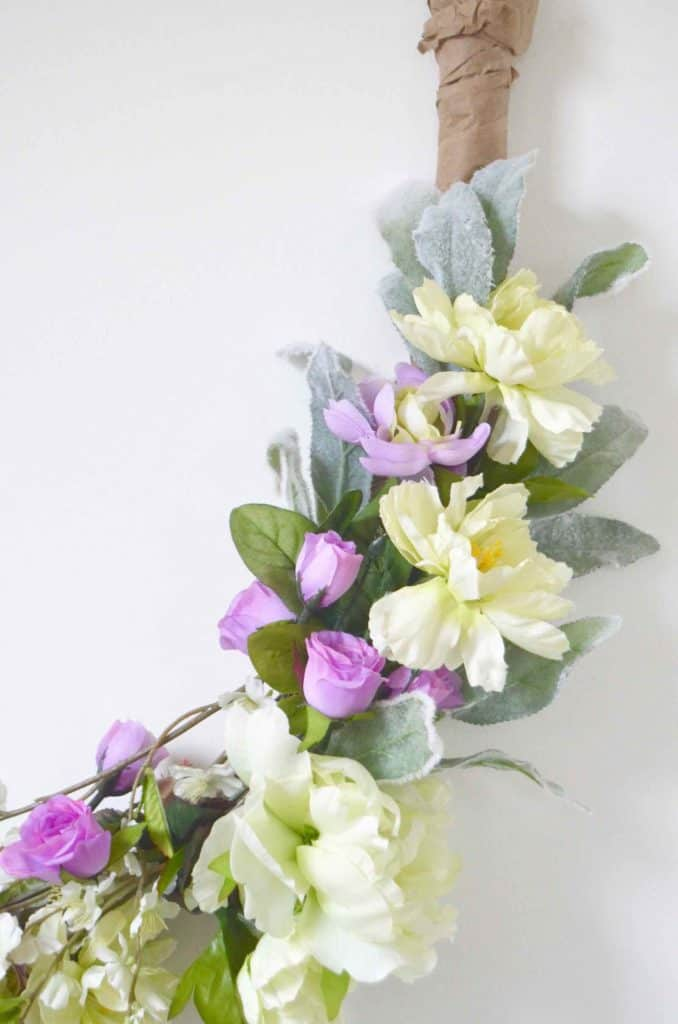 Make a simple, inexpensive spring wreath out of coat hangers!