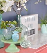 Lush coral and blue eclectic easter tablescape.