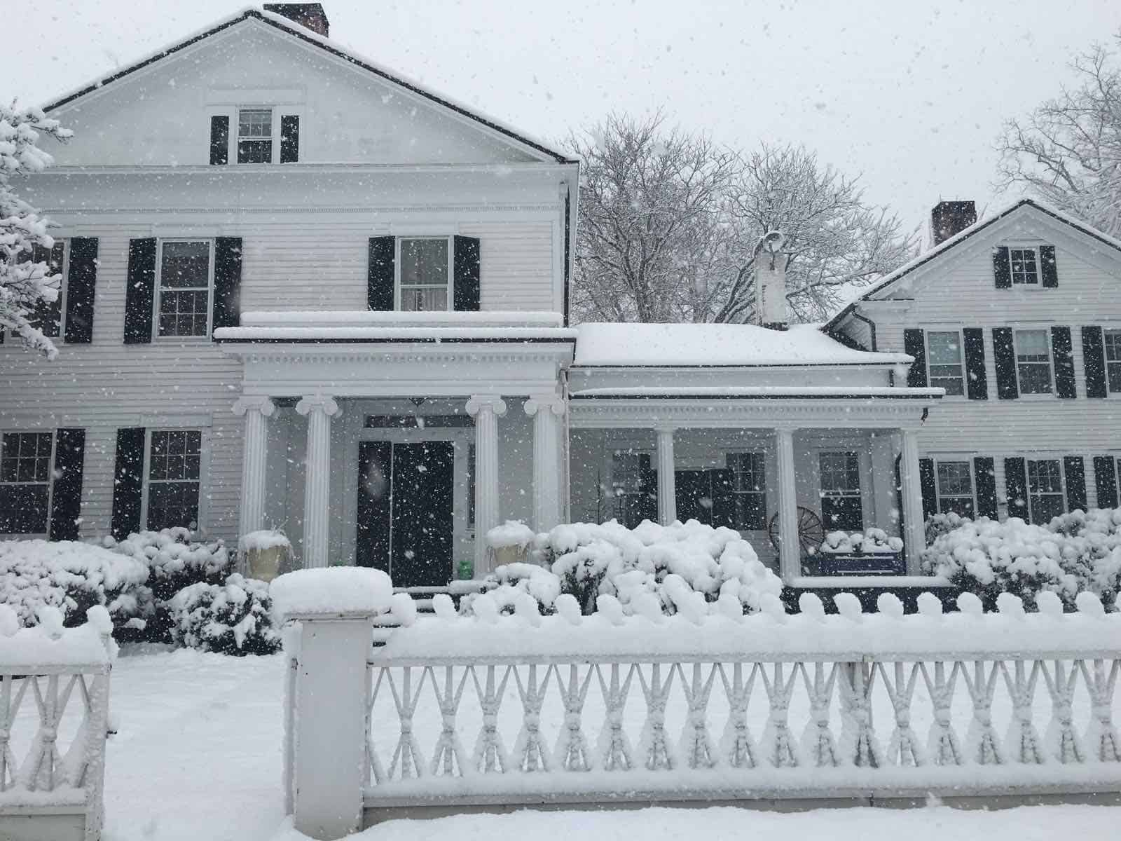 exterior of house in snow storm