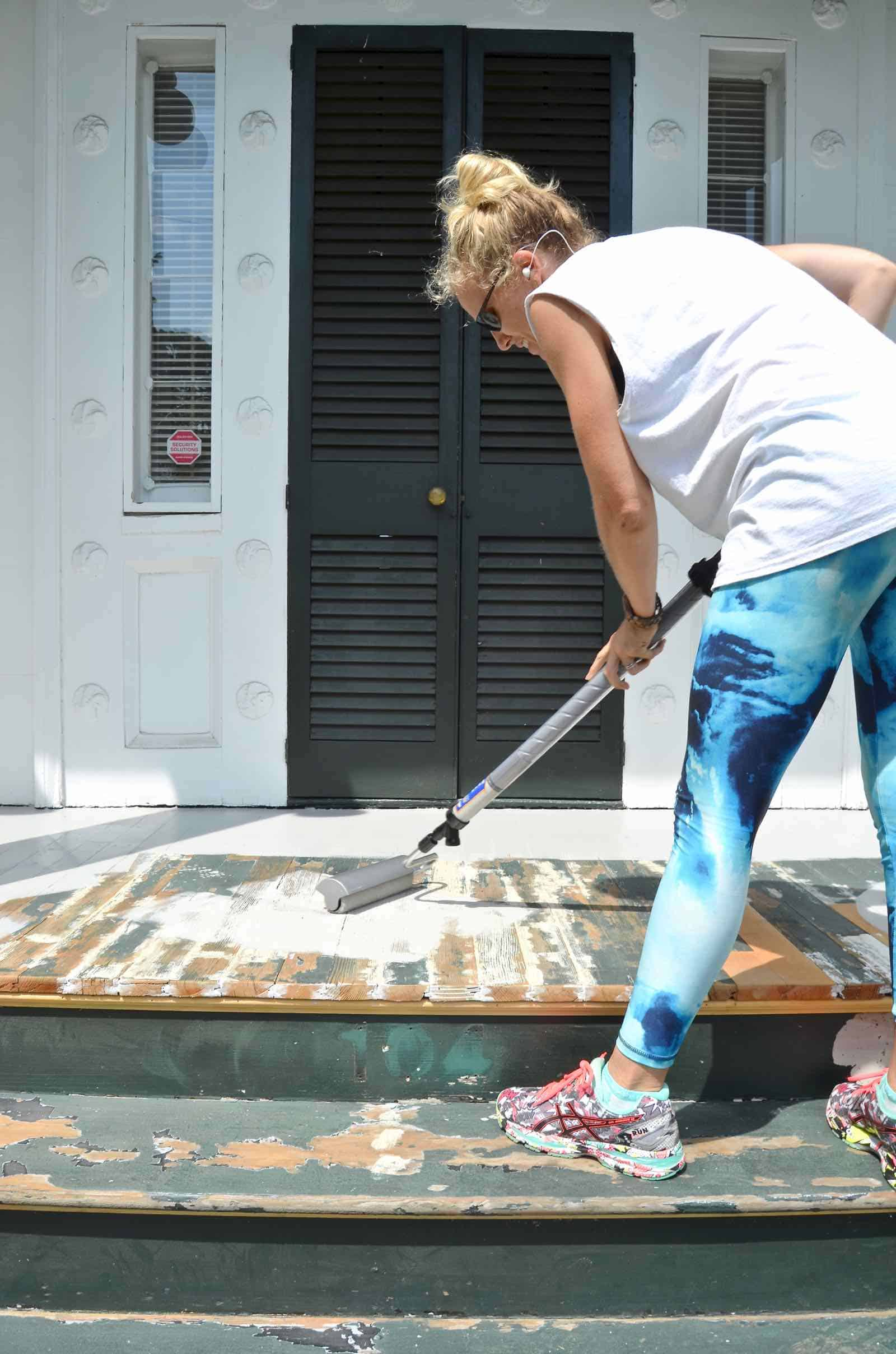 painting the porches with homeright paint stick