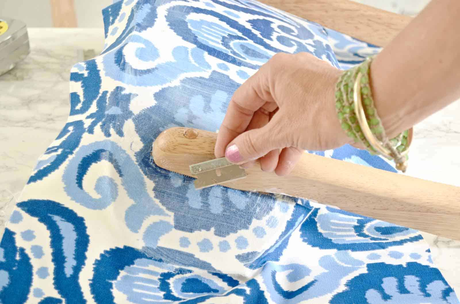 use a sharp blade to trim fabric around back rest
