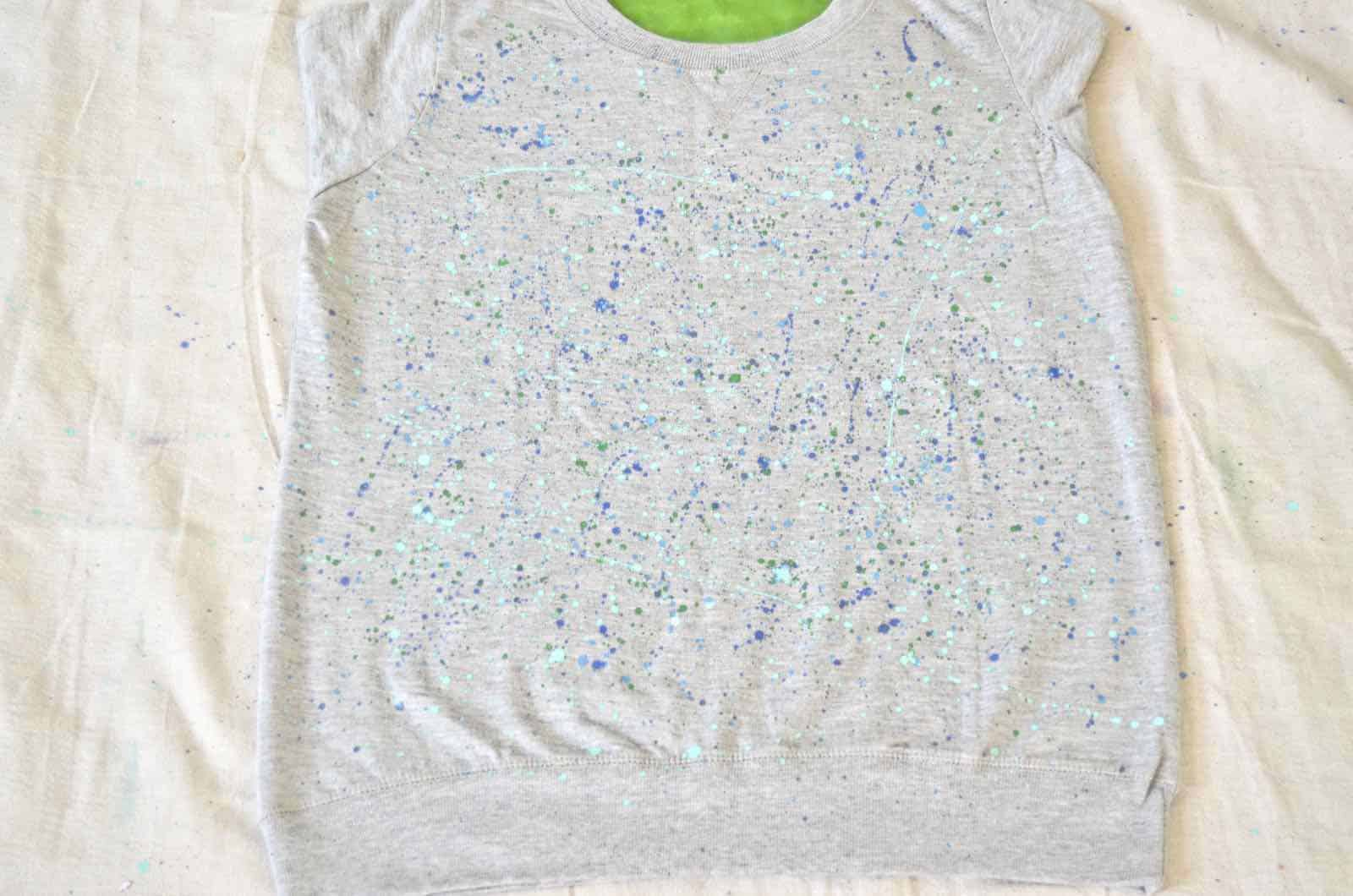 splatter painting a sweatshirt