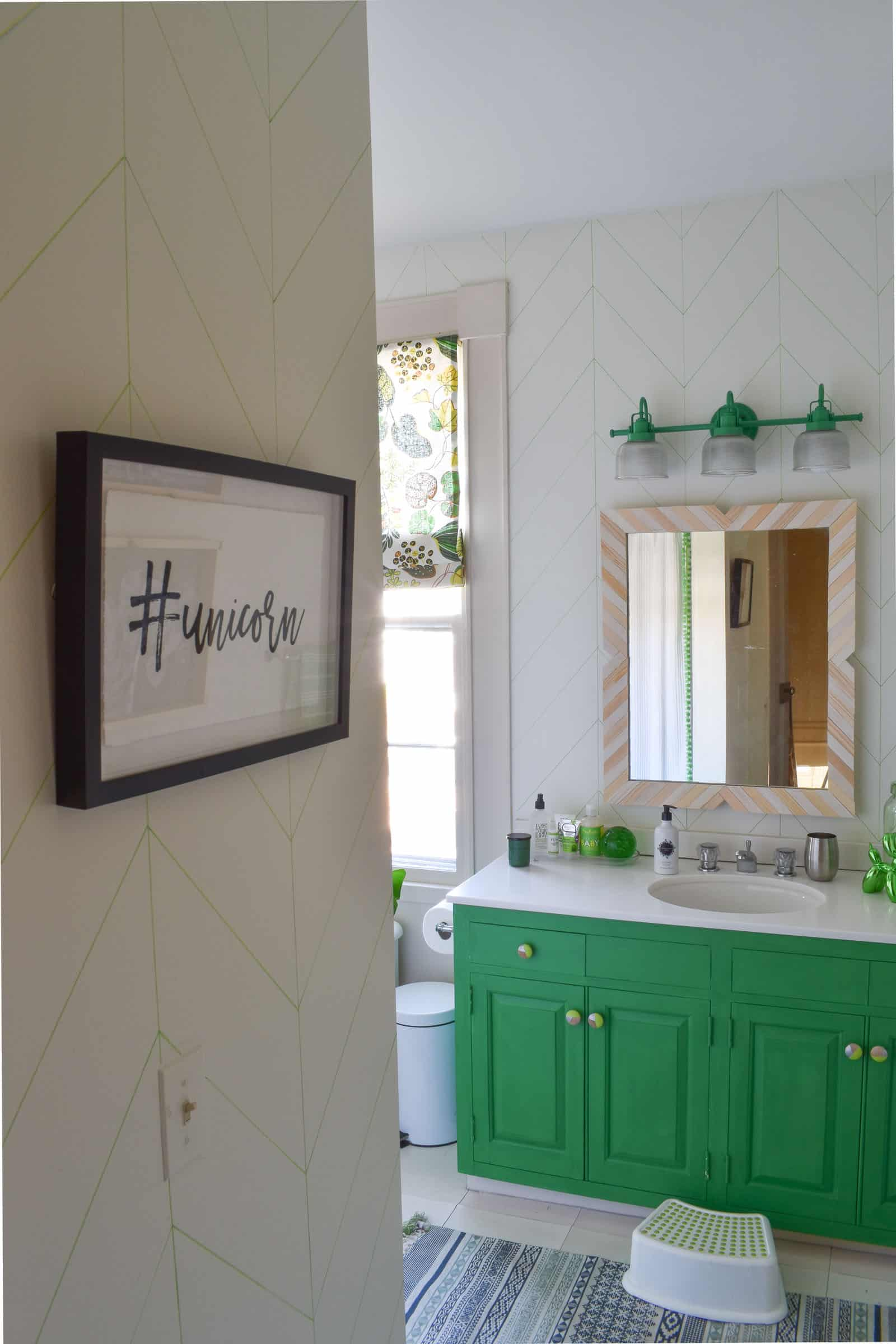 painted green vanity in bathroom