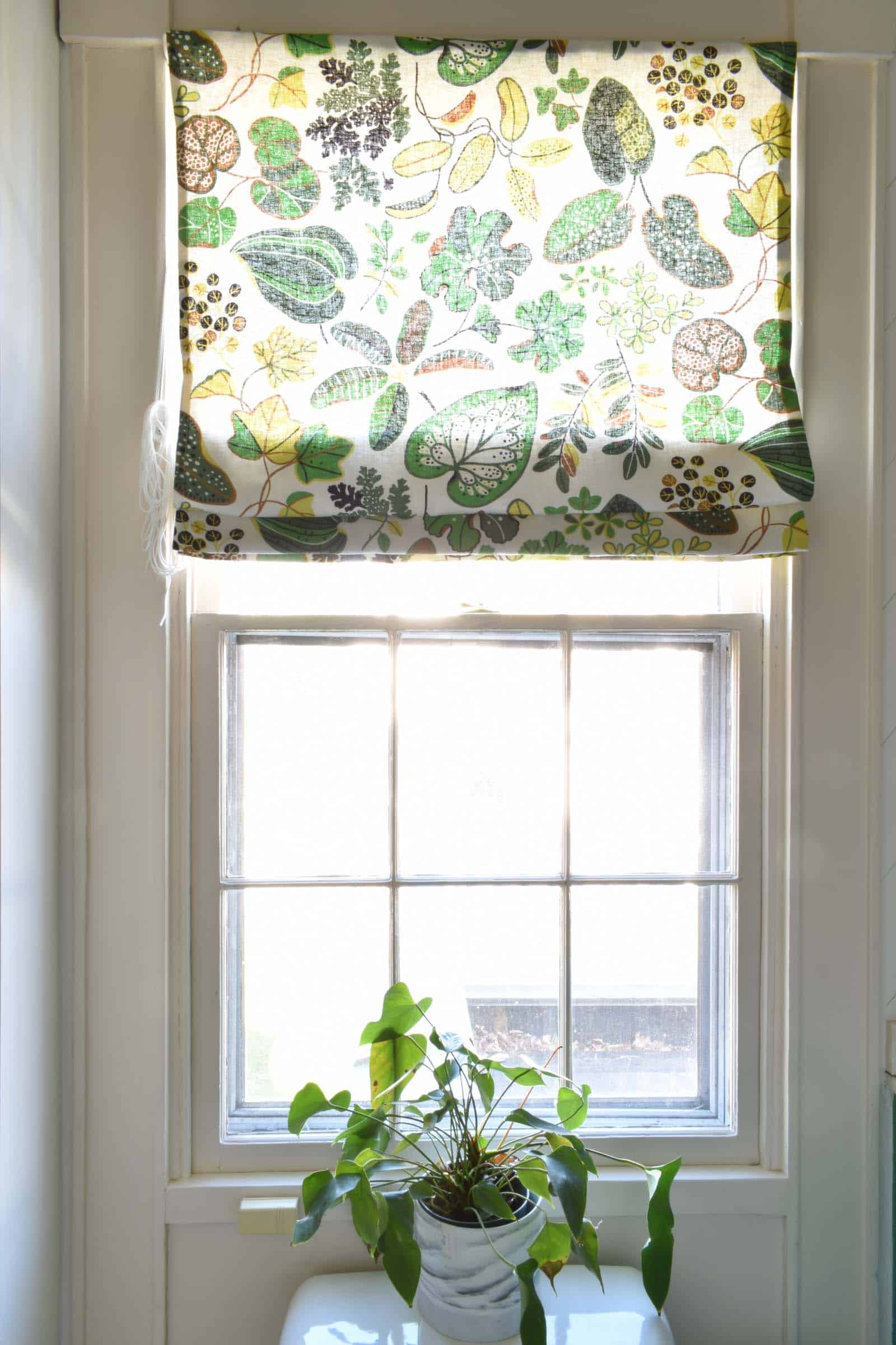 curtain turned roman shade in bathroom