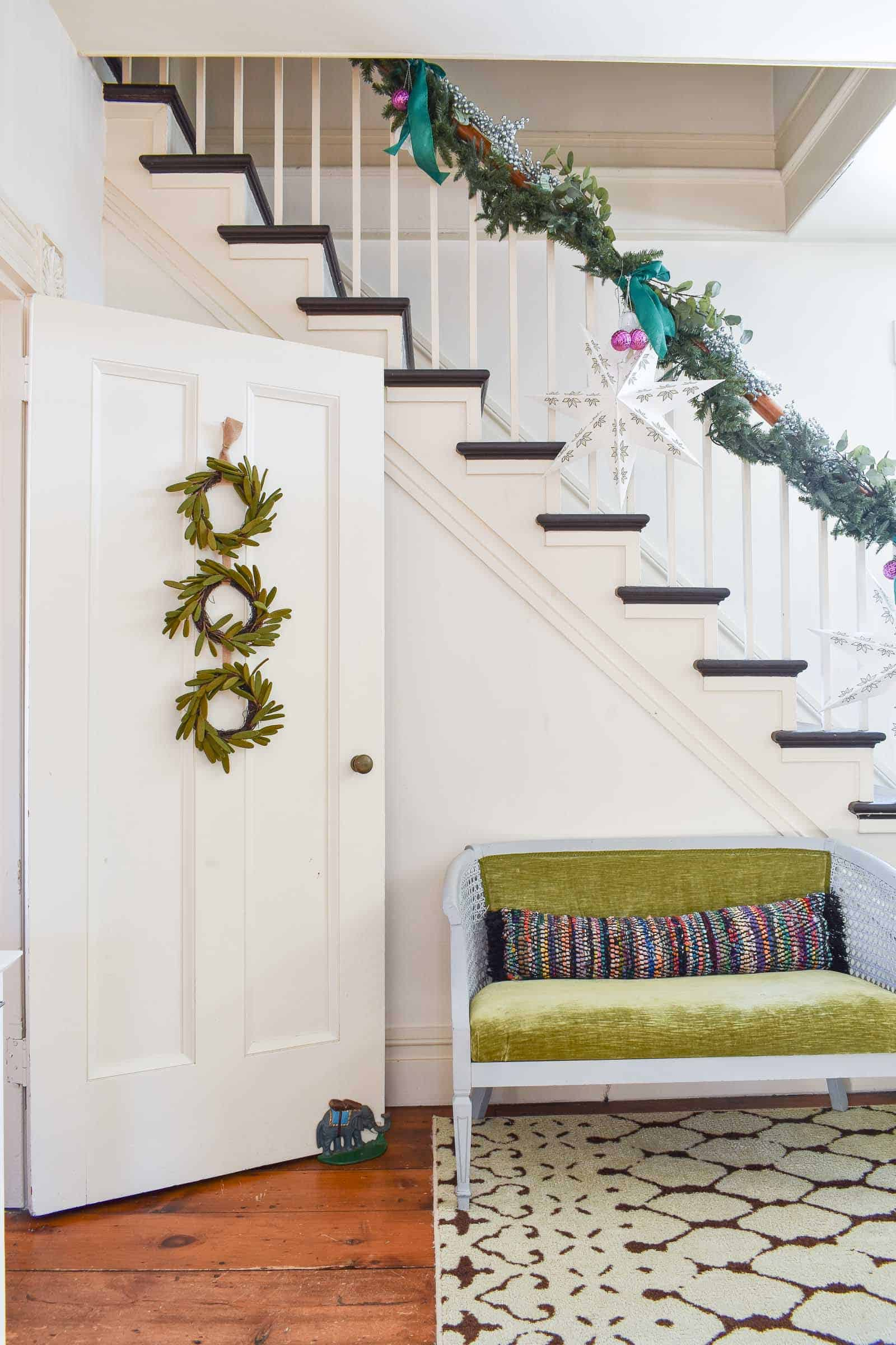 garland draped on banister in foyer