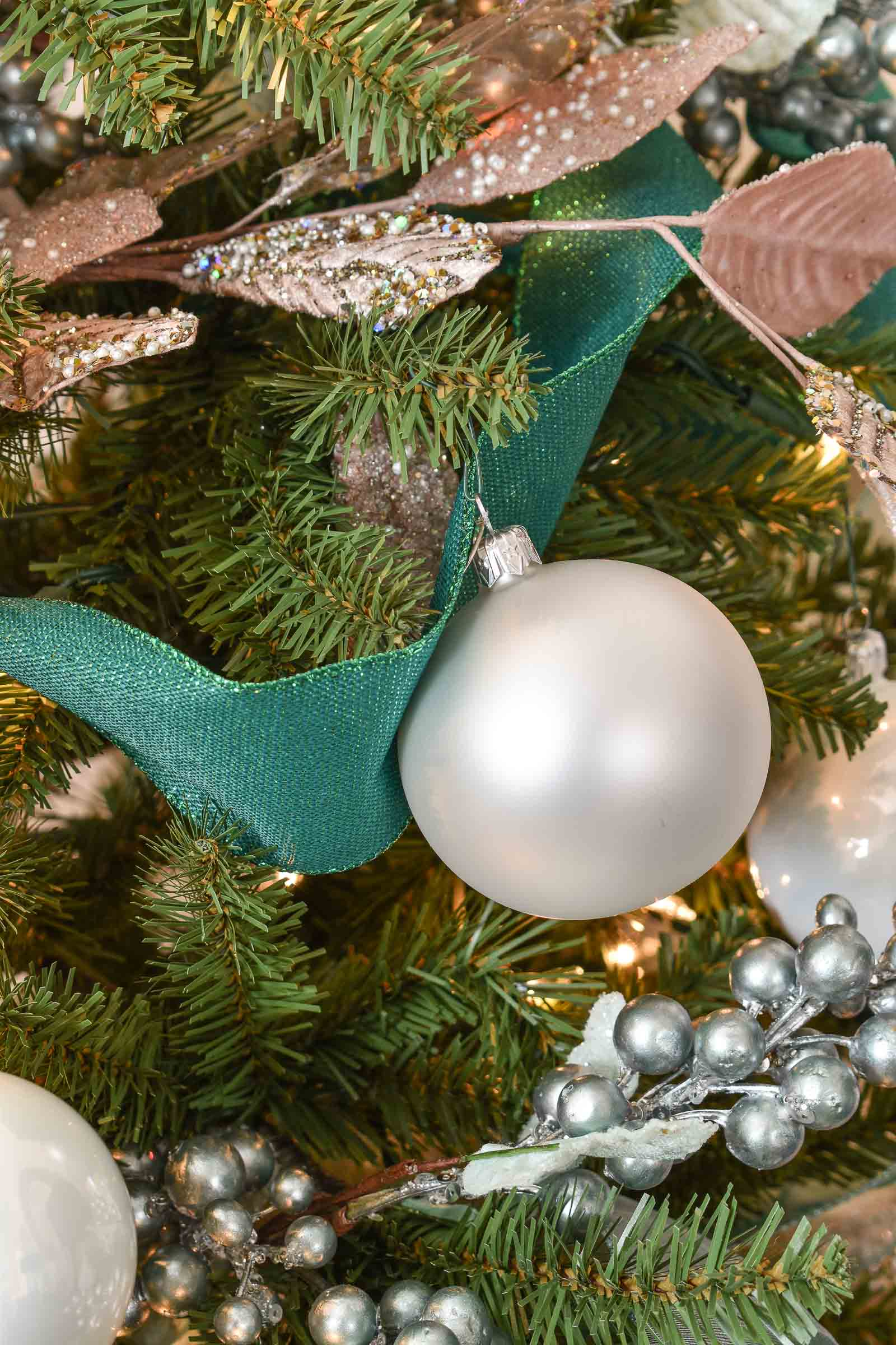 white ornaments on christmas tree