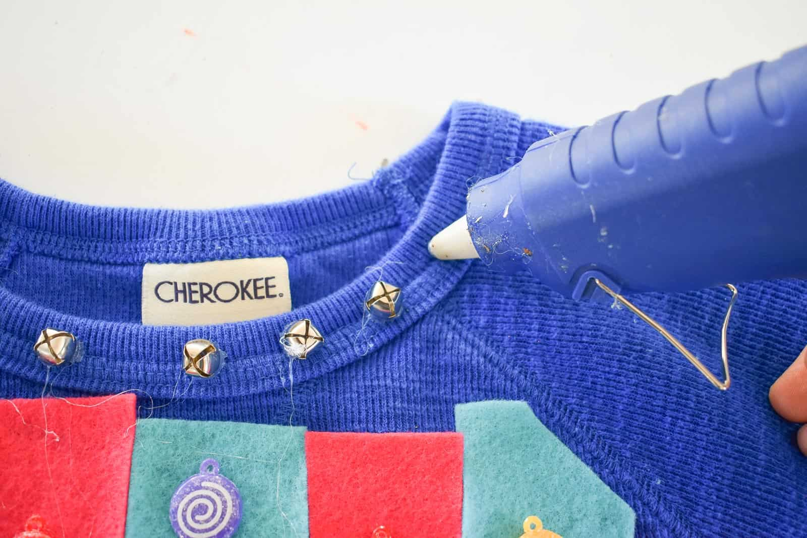 glue on bells to sweatshirt