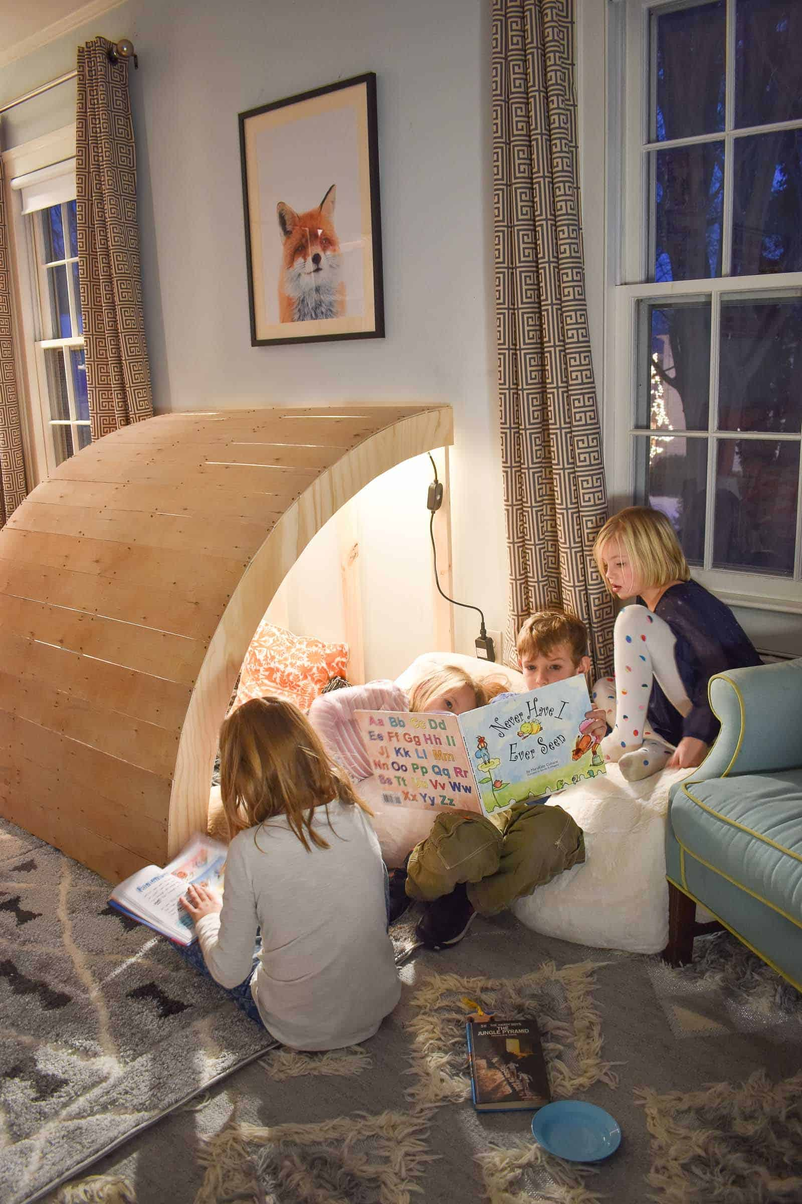 children sitting in reading nook
