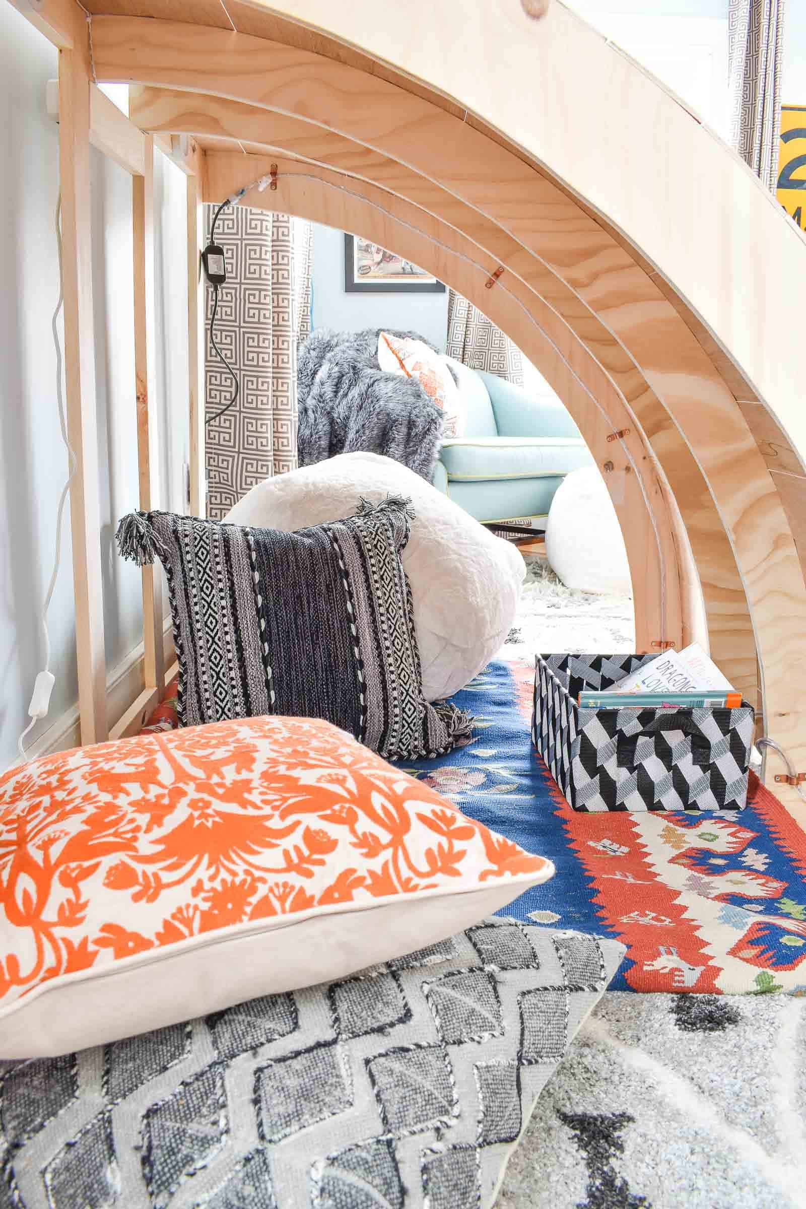 reading nook with cozy blankets and storage