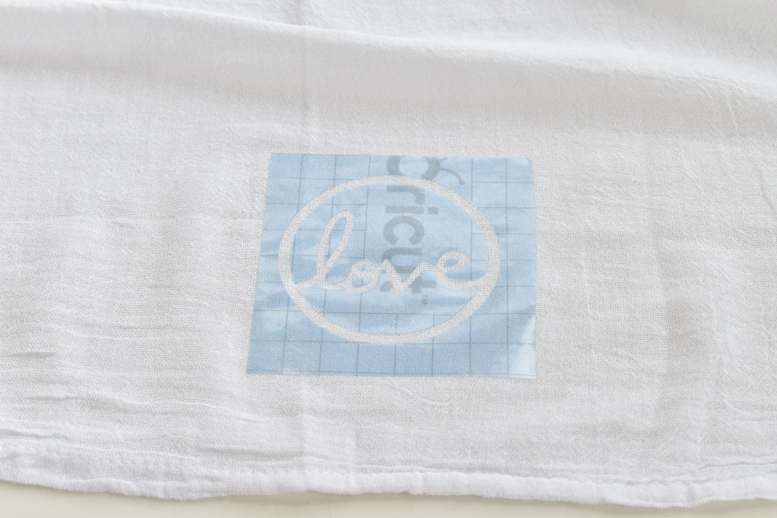 place the stencil onto the towel
