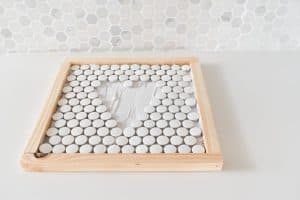 spread on mortar and place tiles