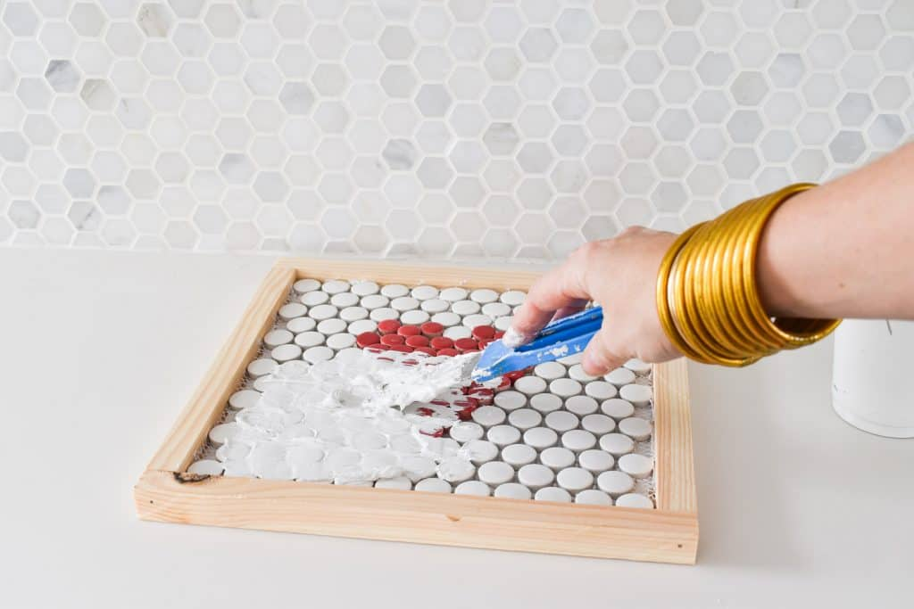 grout penny tiles on trivet