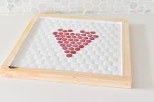 grout penny tiles on trivet