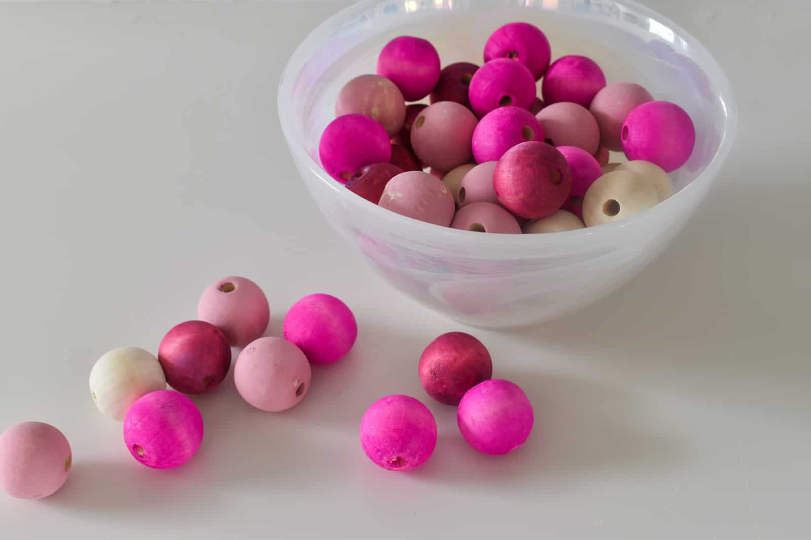 red and pink colored wooden beads