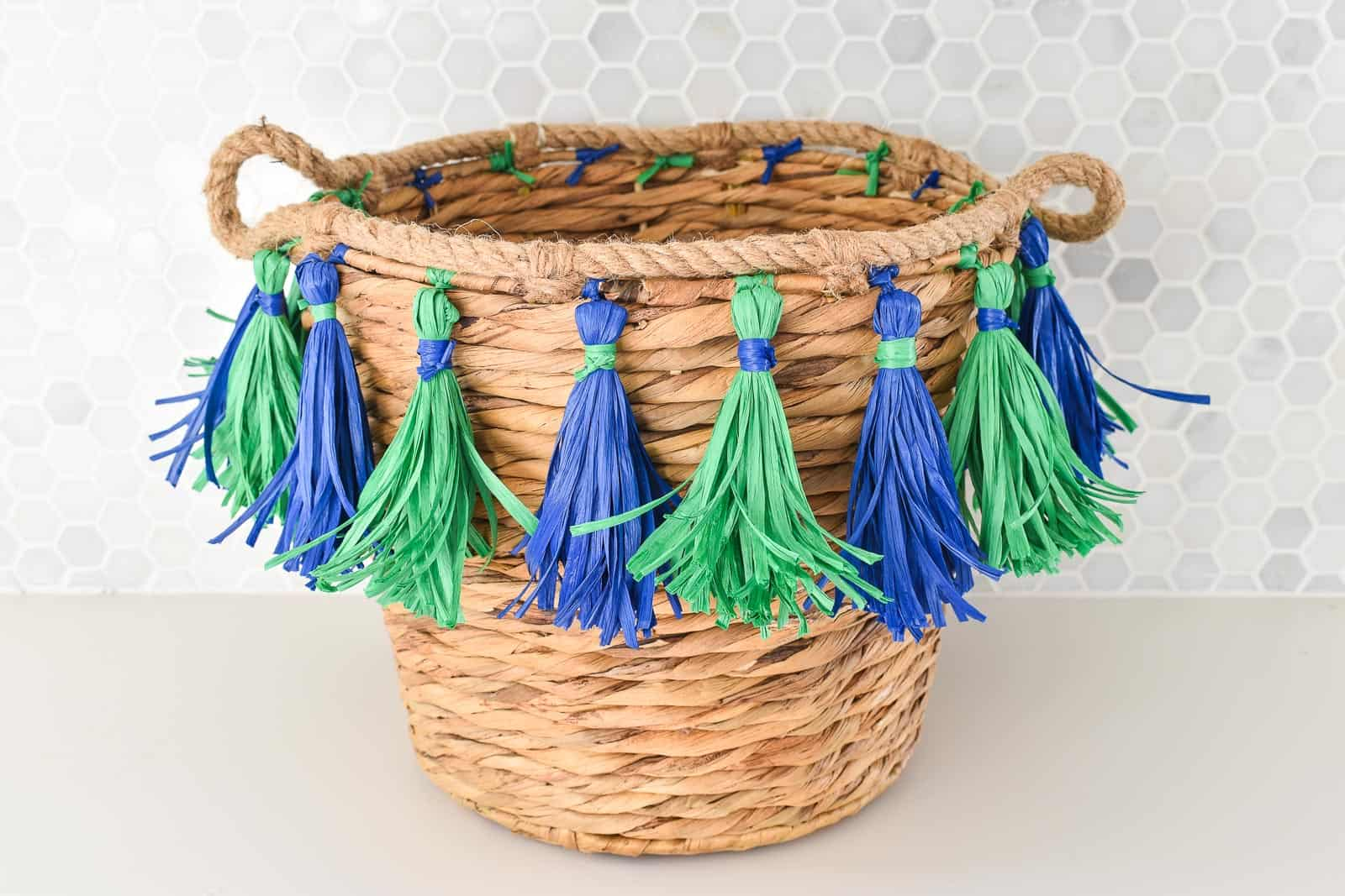 tie tassels onto basket