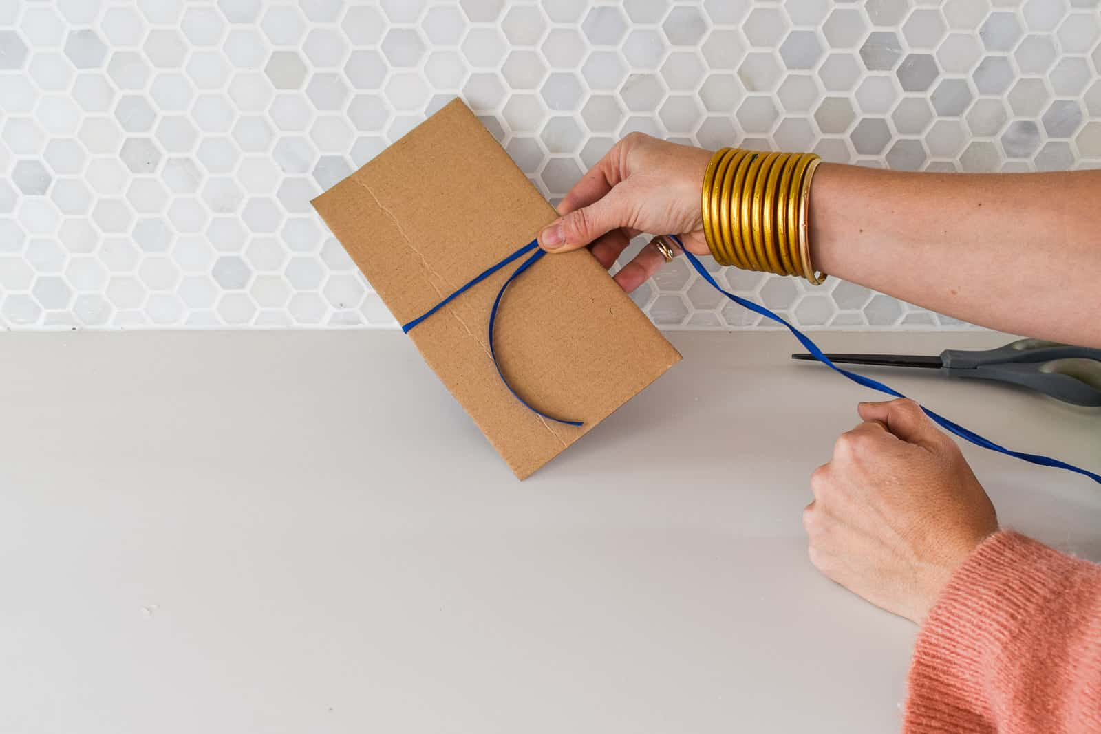 wrapping raffia around cardboard