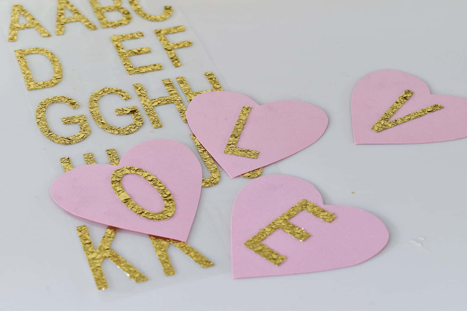 place stickers onto paper hearts