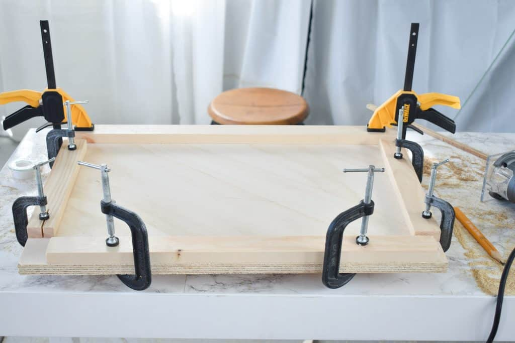 clamped 1x2s around wood for router design