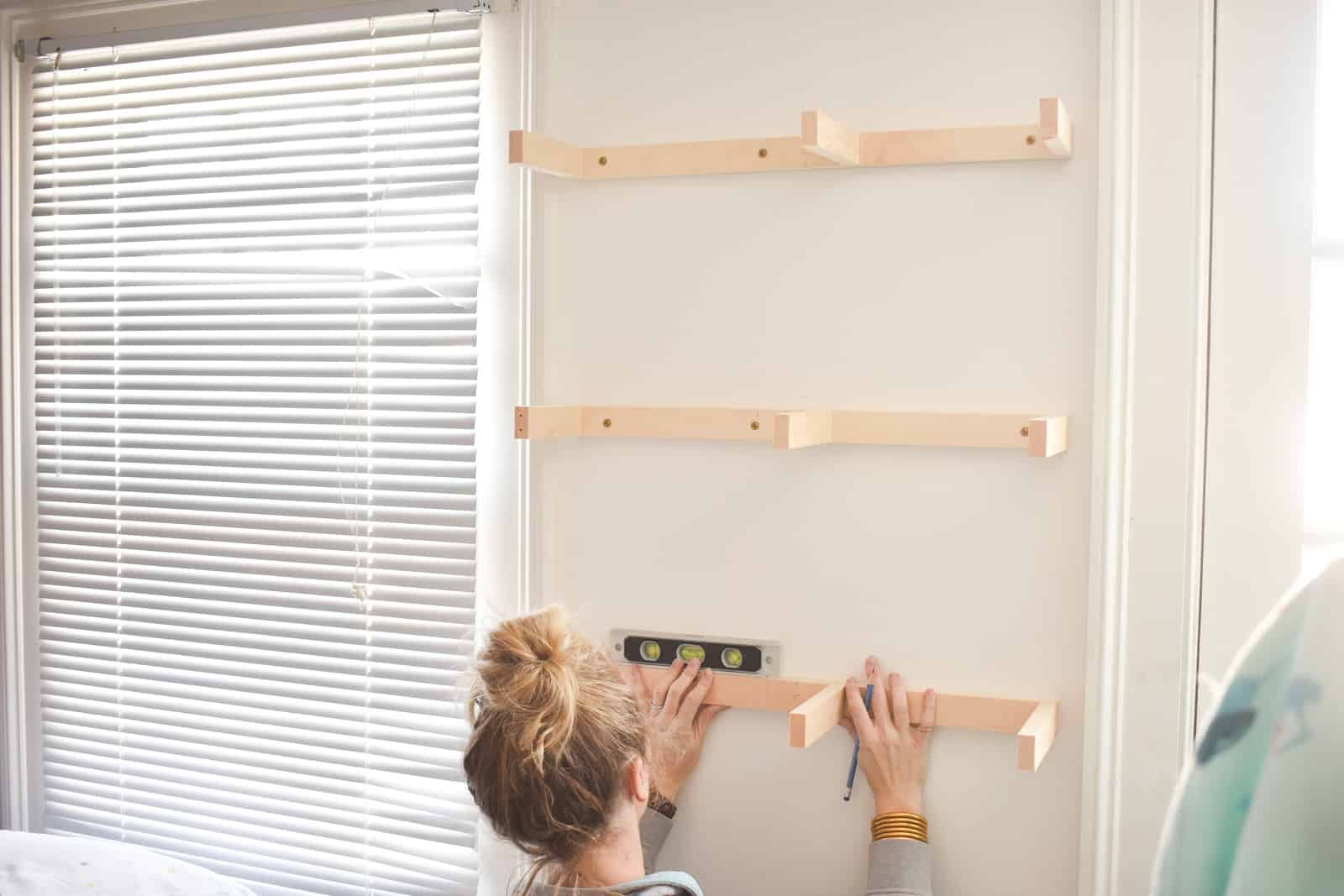 Attach all brackets to floating shelves