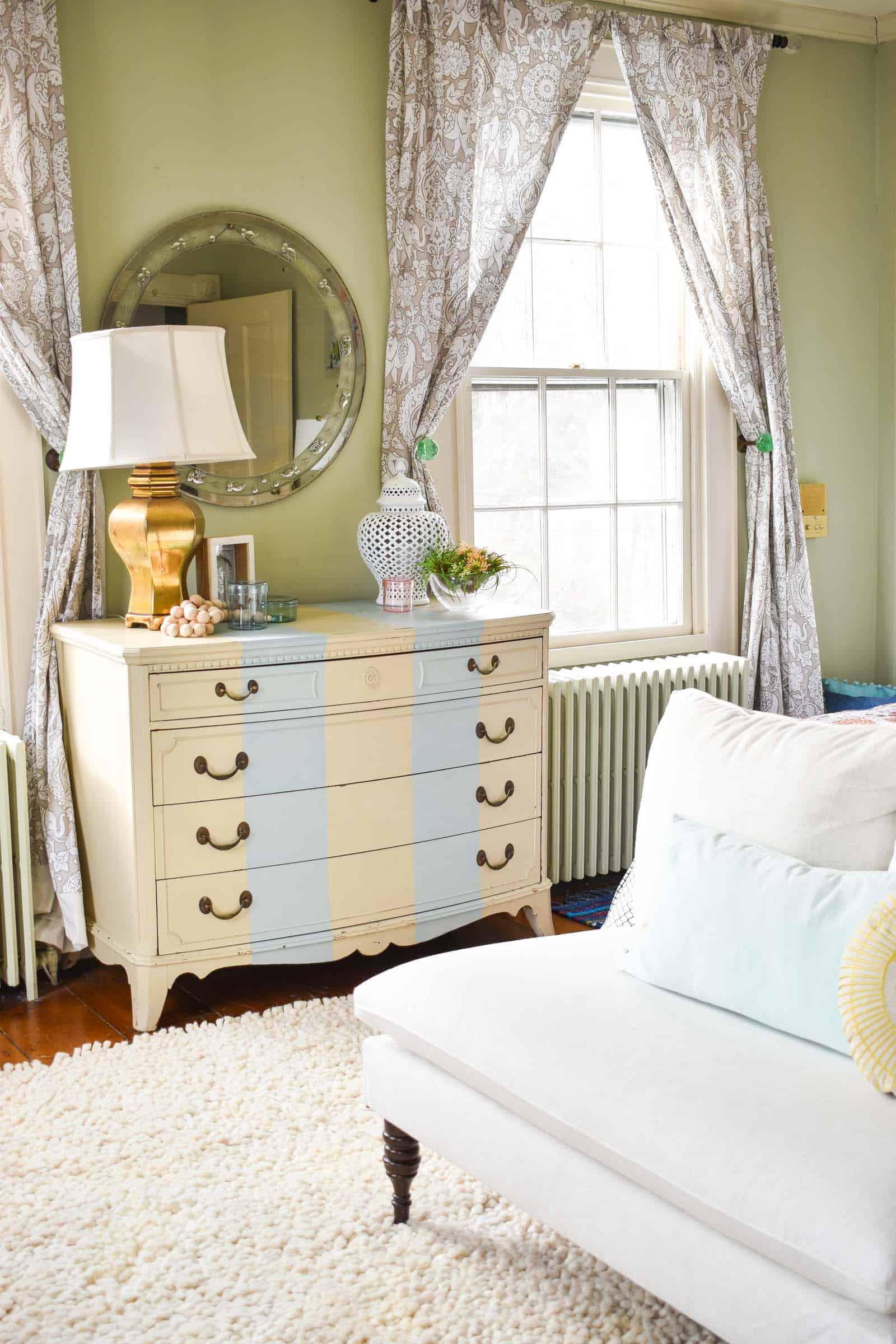 striped dresser in bedroom