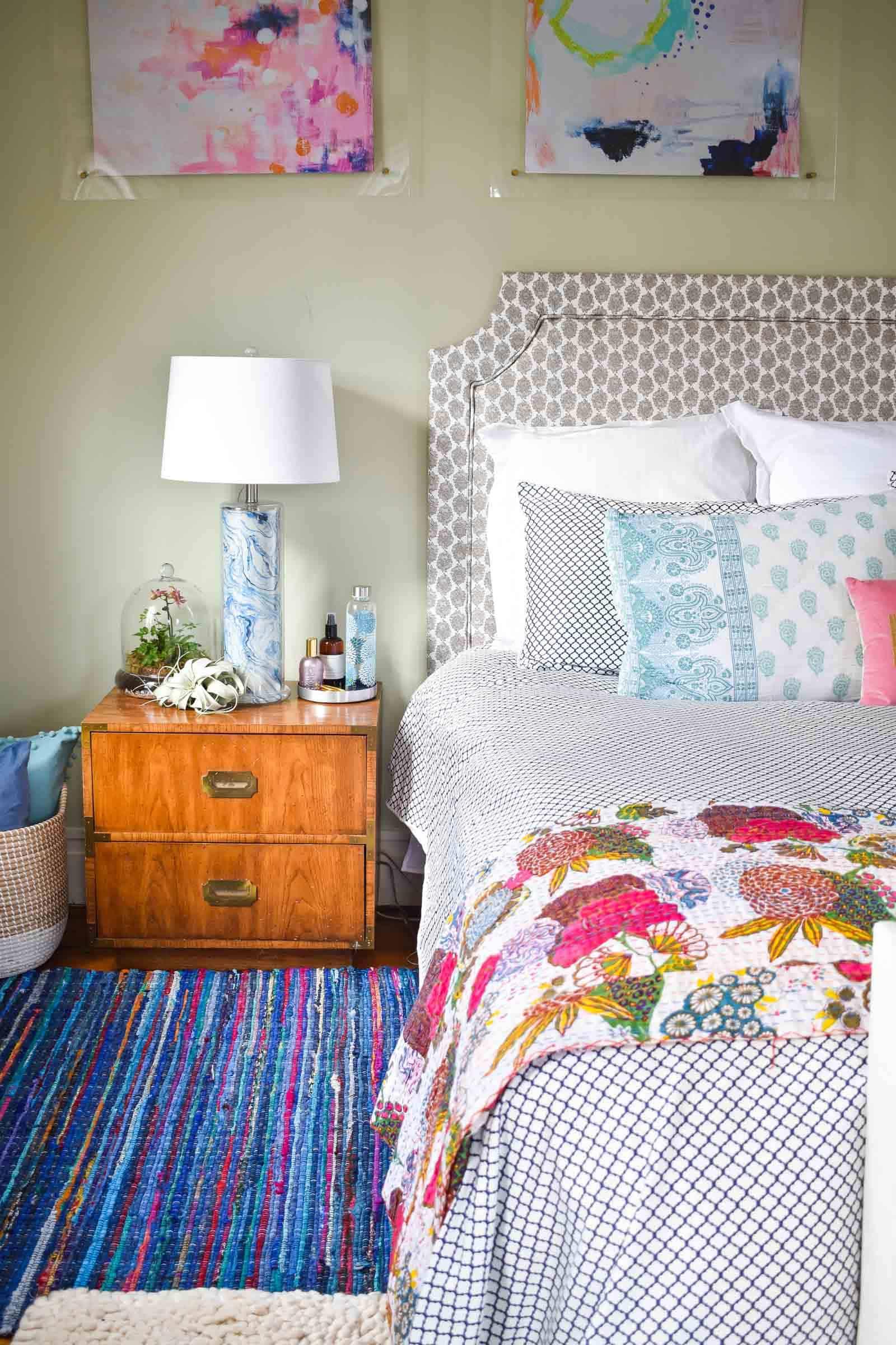 rag rug next to bed in master bedroom