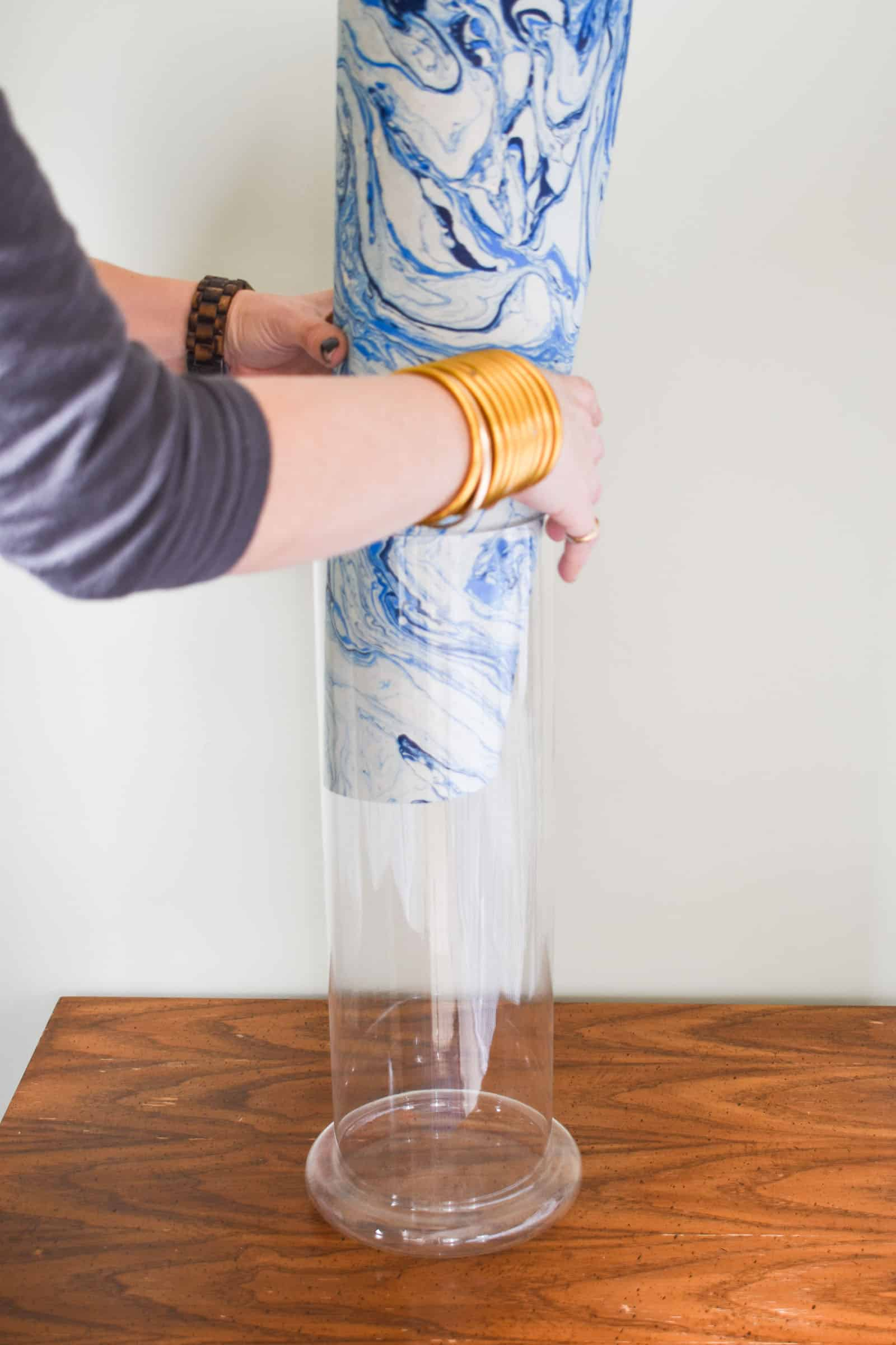 place paper into glass lamp