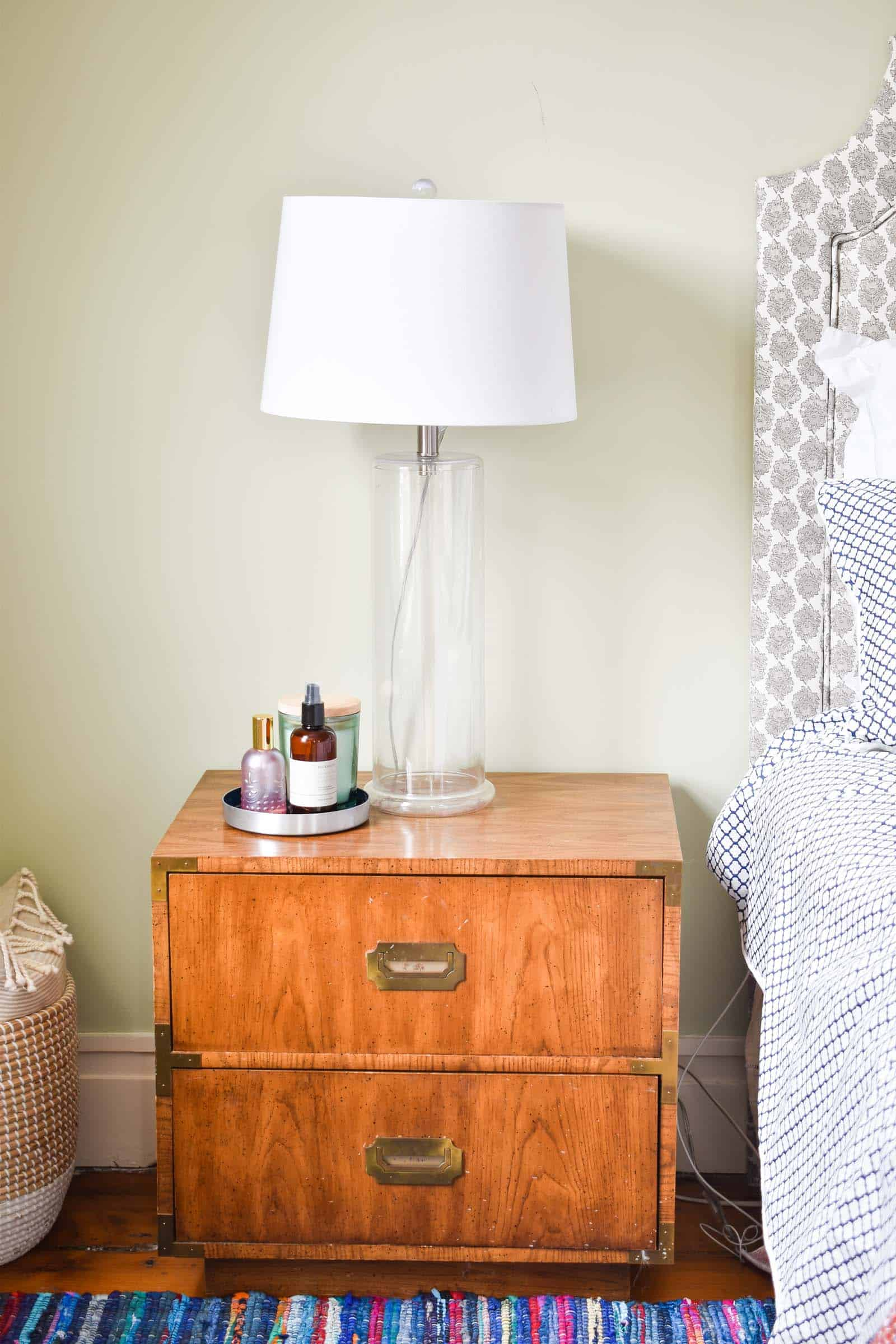 glass lamp next to bed in master