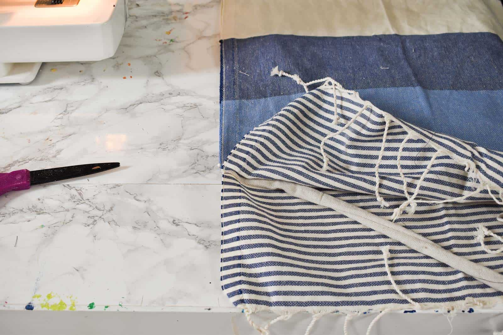 sew tabs onto turkish towel cover