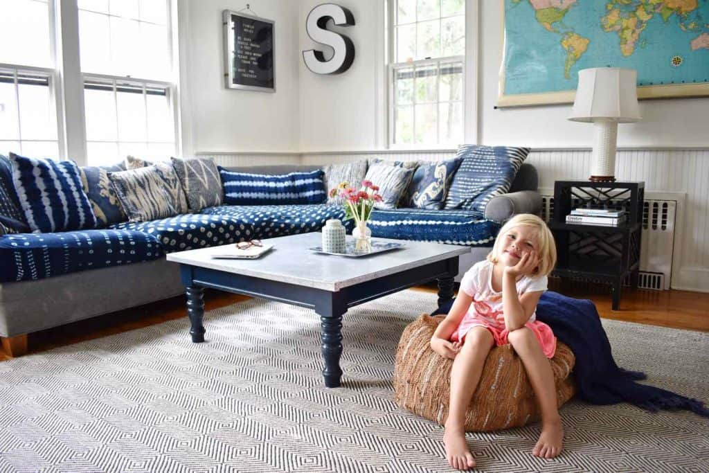 dark couches, patterned rug for kids decor