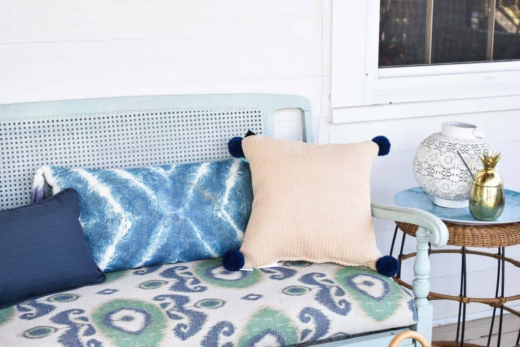 straw pillow on coastal porch