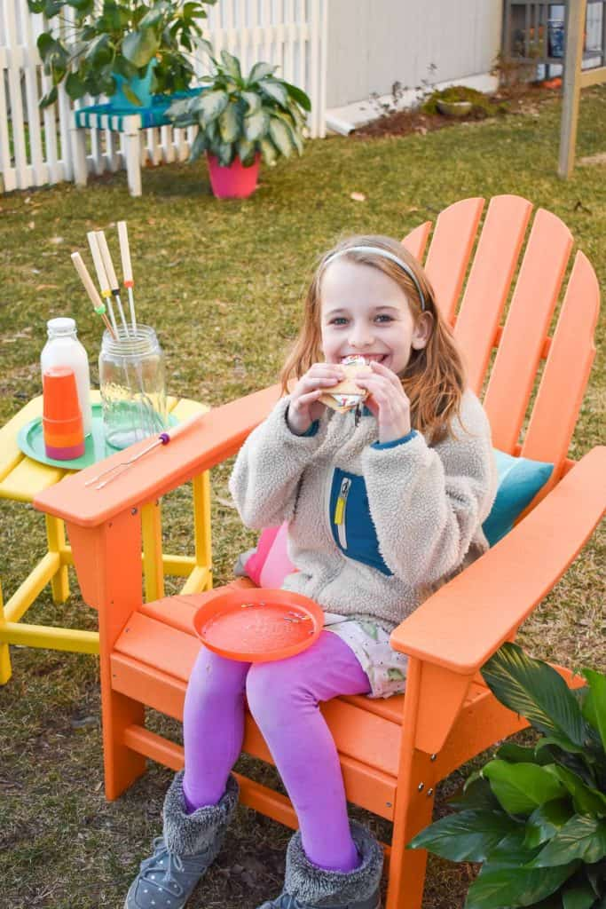 enjoying s'mores in colorful adirdonack