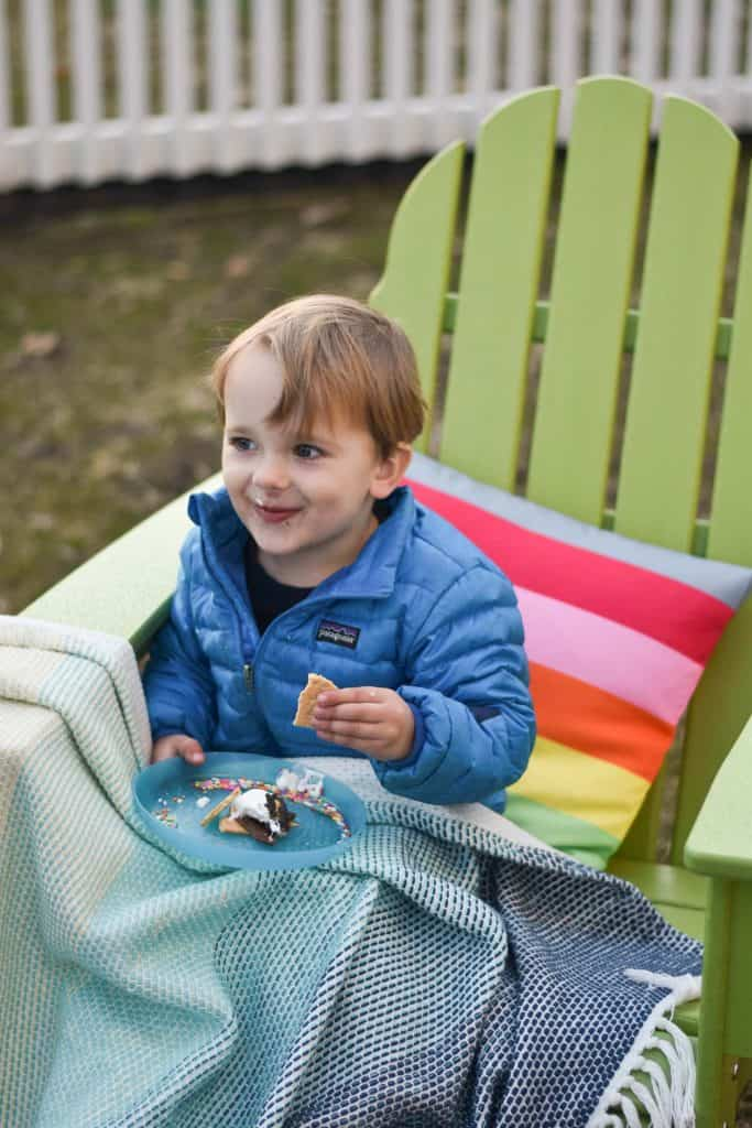 enjoying our fire pit, our rainbow furniture and s'mores