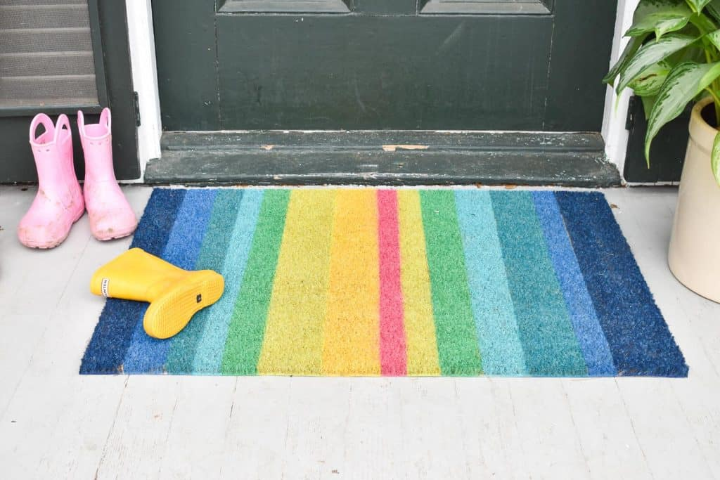 spray painted rainbow doormat