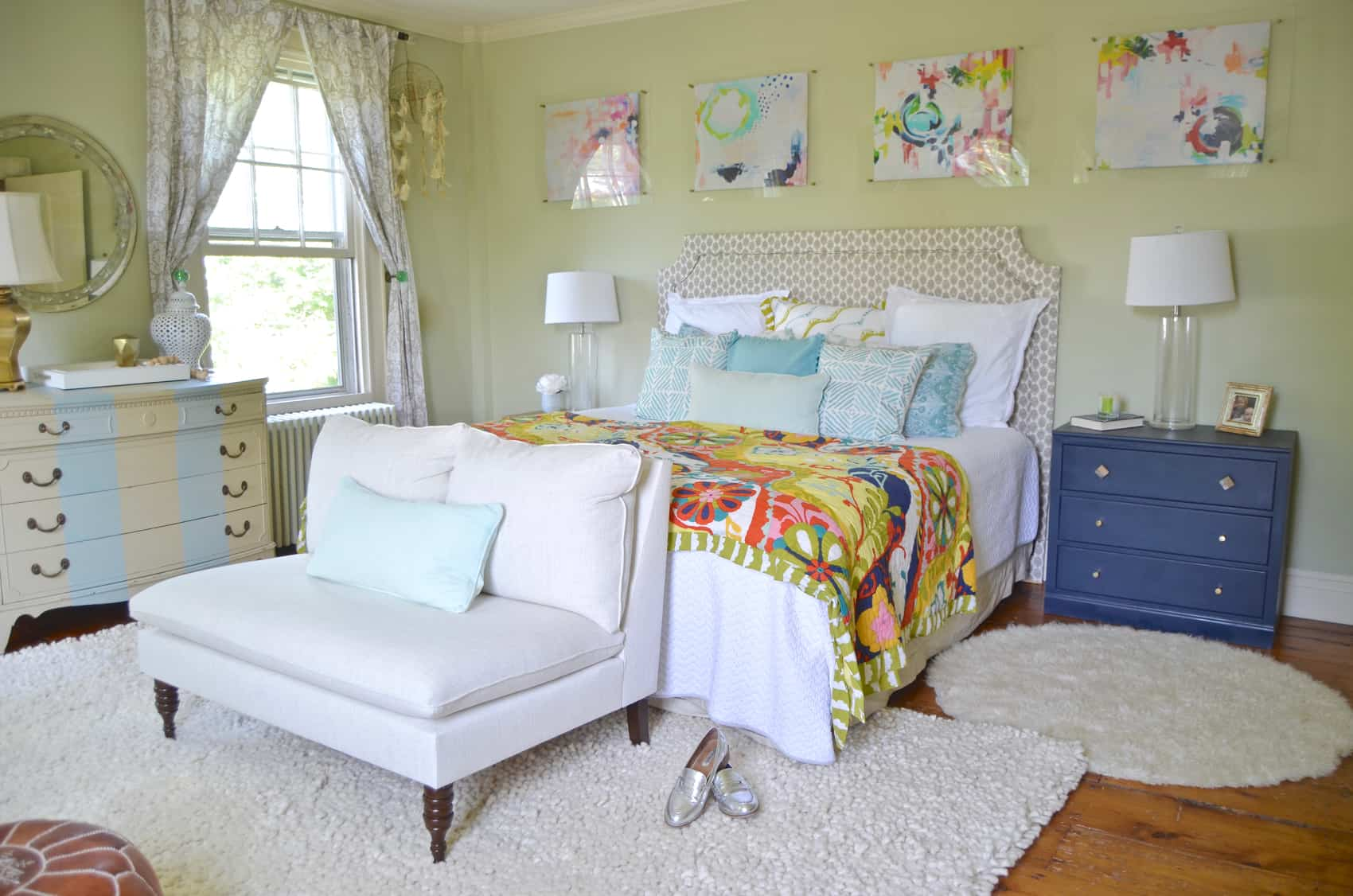 master bedroom with colorful art above the bed