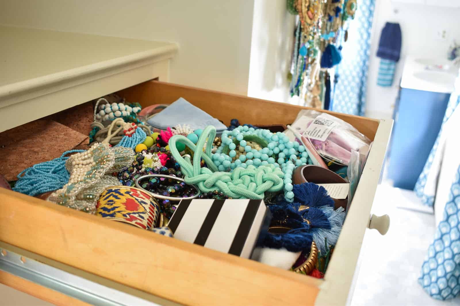 top drawer overflowing with jewelry